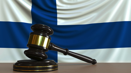 Judges gavel and block against the flag of Finland. Finnish court conceptual 3D rendering Imagens
