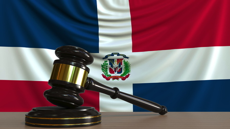 Judges gavel and block against the flag of the Dominican Republic. National court conceptual 3D rendering