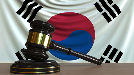 Judges gavel and block against the flag of South Korea. Korean court conceptual 3D rendering
