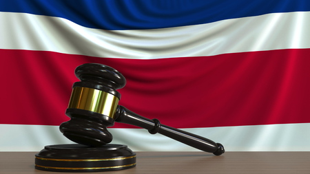 Judges gavel and block against the flag of Costa Rica. National court conceptual 3D rendering Imagens