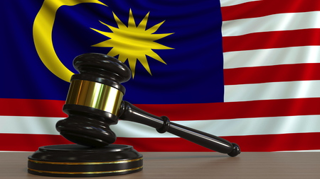 Judges gavel and block against the flag of Malaysia. Malaysian court conceptual 3D rendering
