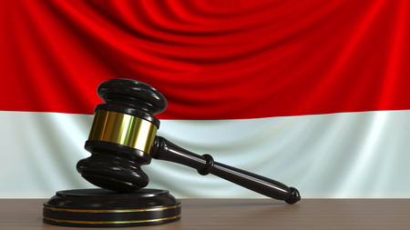 Judges gavel and block against the flag of Indonesia. Indonesian court conceptual 3D rendering Imagens