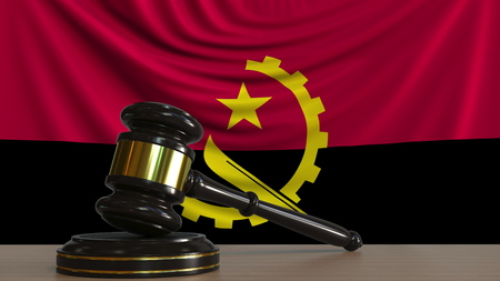 Judges gavel and block against the flag of Angola. Angolan court conceptual 3D rendering Imagens