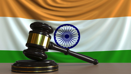 Judges gavel and block against the flag of India. Indian court conceptual 3D rendering