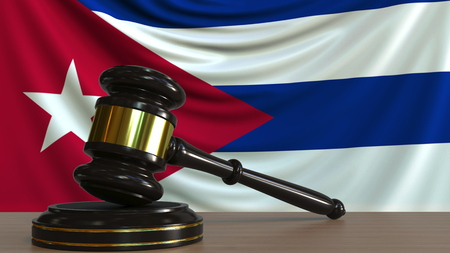 Judges gavel and block against the flag of Cuba. Cuban court conceptual 3D rendering