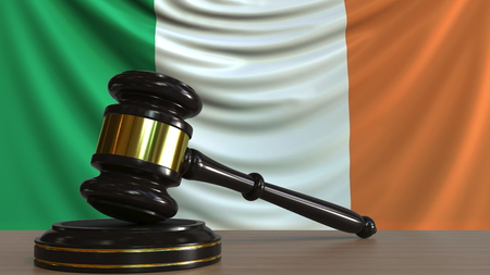 Judges gavel and block against the flag of the Republic of Ireland. Irish court conceptual 3D rendering Imagens