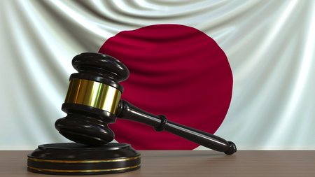 Judges gavel and block against the flag of Japan. Japanese court conceptual 3D rendering