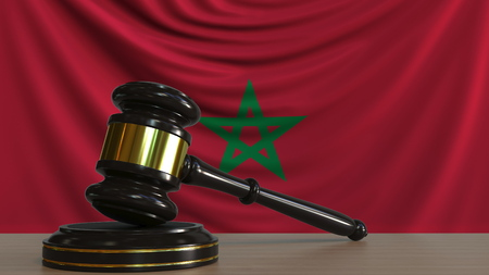 Judges gavel and block against the flag of Morocco. Moroccan court conceptual 3D rendering Imagens