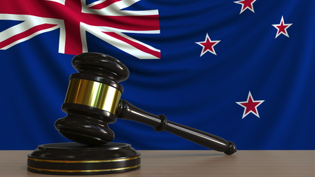 Judges gavel and block against the flag of New Zealand. Court conceptual 3D rendering