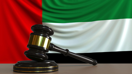 Judges gavel and block against the flag of the United Arab Emirates. UAE court conceptual 3D rendering
