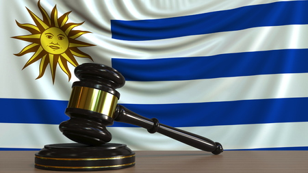Judges gavel and block against the flag of Uruguay. Uruguayan court conceptual 3D rendering