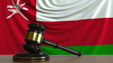 Judges gavel and block against the flag of Oman. Omani court conceptual 3D rendering
