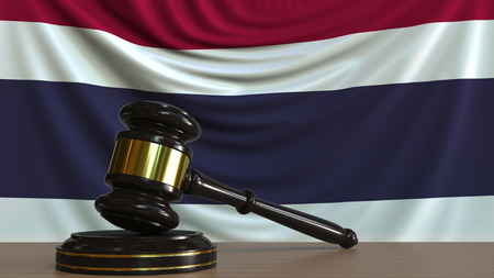 Judges gavel and block against the flag of Thailand. Thai court conceptual 3D rendering