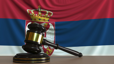 Judges gavel and block against the flag of Serbia. Serbian court conceptual 3D rendering Imagens