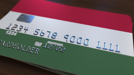 Plastic bank card featuring flag of Hungary. Hungarian national banking system related 3D rendering