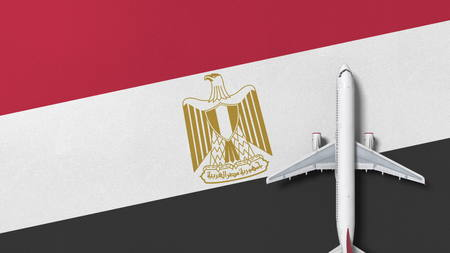 Top-down view of the airplane on the flag of Egypt. Tourism related conceptual 3D rendering Фото со стока