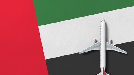 Airplane on the flag of the United Arab Emirates UAE. Flights related conceptual 3D rendering Фото со стока