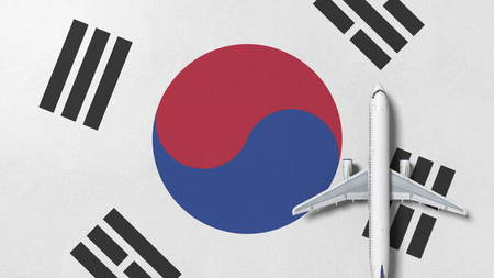 Airplane on the flag of Korea. Flights related conceptual 3D rendering 免版税图像