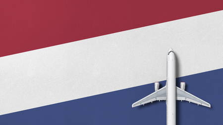 Airplane on the flag of Netherlands. Flights related conceptual 3D rendering Фото со стока