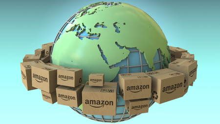 Boxes with AMAZON logo rotate around the world, Africa and Europe emphasized. Conceptual editorial 3D rendering 에디토리얼
