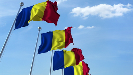 Row of waving flags of Romania agaist blue sky, 3D rendering
