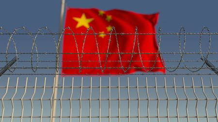 Blurred waving flag of China behind barbed wire fence. 3D rendering Banco de Imagens