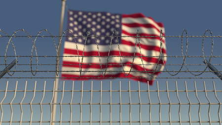 Defocused waving flag of the United States behind barbed wire fence. 3D rendering