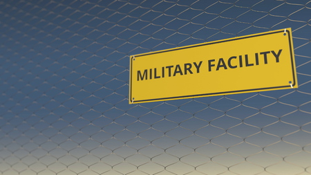 MILITARY FACILITY sign an a mesh wire fence against blue sky. 3D rendering