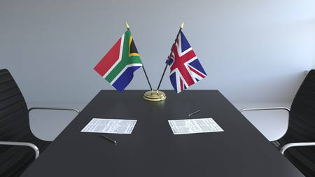 Flags of South Africa and the United Kingdom and papers on the table. Negotiations and signing an international agreement. Conceptual 3D rendering Reklamní fotografie