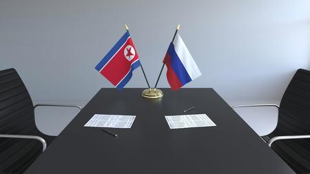 Banderas de Corea del Norte y Rusia y papeles sobre la mesa. Negociaciones y firma de convenio internacional. Representación 3D conceptual