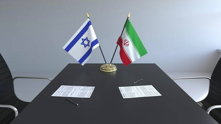 Flags of Israel and Iran and papers on the table. Negotiations and signing an international agreement. Conceptual 3D rendering 스톡 콘텐츠