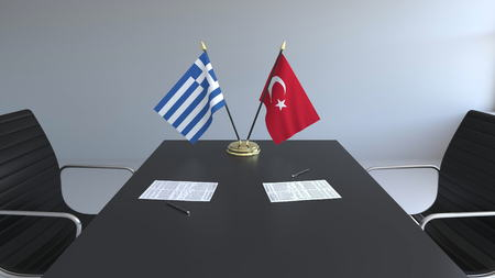 Flags of Greece and Turkey and papers on the table. Negotiations and signing an international agreement. Conceptual 3D rendering