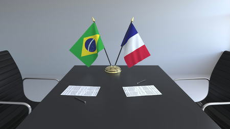 Flags of Brazil and France and papers on the table. Negotiations and signing an international agreement. Conceptual 3D rendering