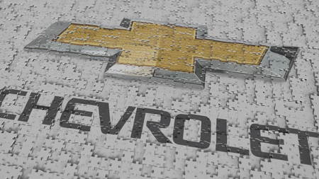 Logo of CHEVROLET being made with puzzle pieces, editorial 3D rendering 報道画像