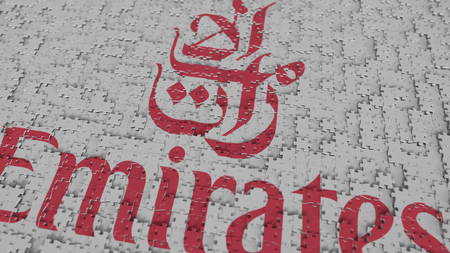 EMIRATES AIRLINES logo composing with puzzle pieces, editorial 3D rendering