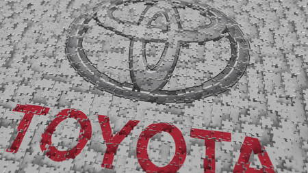 TOYOTA logo composing with puzzle pieces, editorial 3D rendering