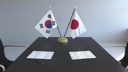 Flags of South Korea and Japan and papers on the table. Negotiations and signing an international agreement. Conceptual 3D rendering