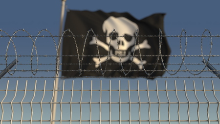 Barbed wire against defocused waving Jolly Roger black pirate flag. Loopable 3D animation