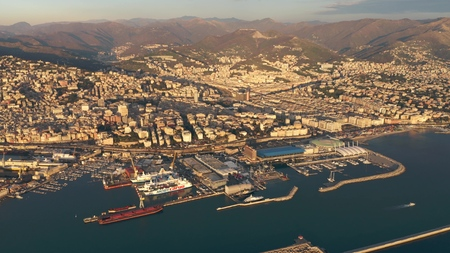 GENOA, ITALY - JANUARY 3, 2019. Aerial view of port and city in the evening