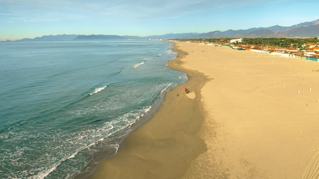 Aerial view of the sand beach in the morning. Forte dei Marmi, Italy
