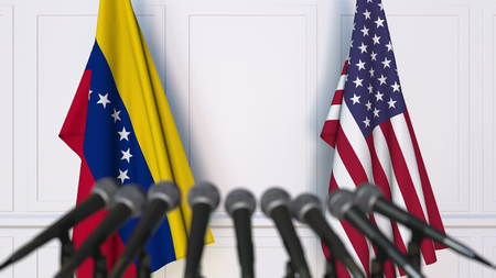 Flags of Venezuela and the United States at international meeting or negotiations press conference. 3D rendering