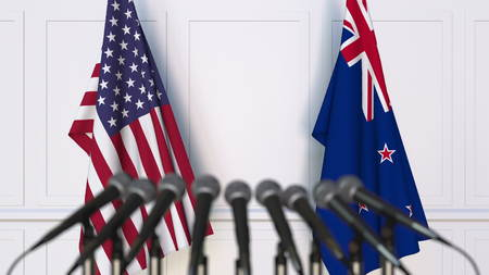 Flags of the United States and New Zealand at international meeting or negotiations press conference. 3D rendering