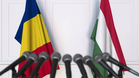 Flags of Romania and Hungary at international meeting or negotiations press conference. 3D rendering Stock Photo