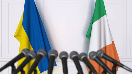 Flags of Ukraine and Ireland at international meeting or negotiations press conference. 3D rendering