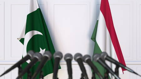Flags of Pakistan and Hungary at international meeting or negotiations press conference. 3D rendering
