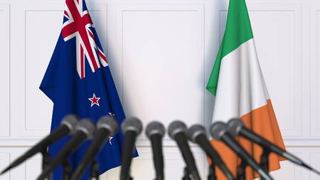 Flags of New Zealand and Ireland at international meeting or negotiations press conference. 3D rendering