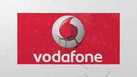 Breaking wall with painted logo of Vodafone. Crisis conceptual editorial 3D rendering
