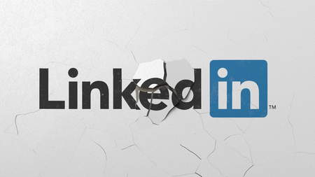 Crushing concrete wall with logo of LinkedIn. Crisis conceptual editorial 3D rendering