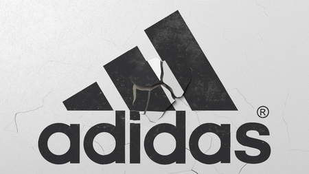 Destroying wall with painted logo of Adidas. Crisis conceptual editorial 3D rendering
