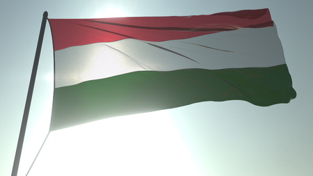 Waving flag of Hungary against shining sun and sky. Realistic loopable 3D rendering Фото со стока